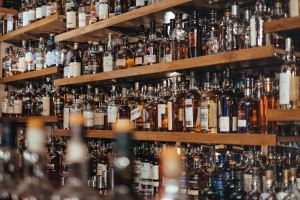 image of the back shelf at a bar with many hundreds of bottles of liquor